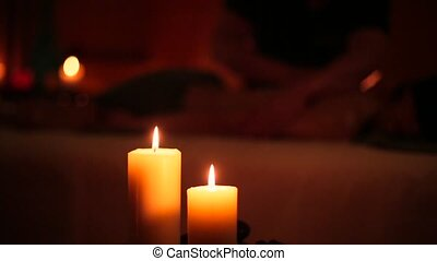 Massage in the spa salon and a candle