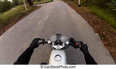Riding a motorcycle first person view.