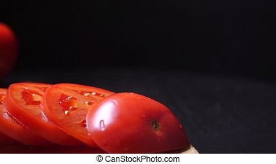 Row of tomato slices and ingredients for Caprese salad