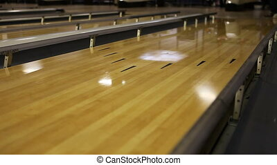 Bowling Ball Being Thrown Down a Lane