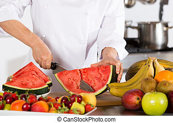 Chef with fruits - Chef cutting a delicious sweet watermelon