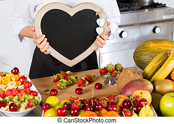 Chef with fruits - Chef with a blackboard in the form of...