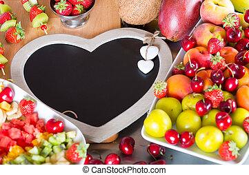 Mixed fruit salad - Table prepared with a variety of fruits...
