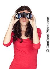Adorable teen girl with binoculars