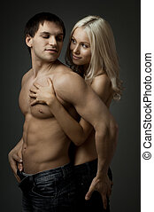 sexy couple - muscular handsome sexy guy with pretty woman,...