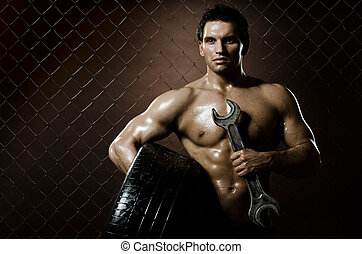 workman - the very muscular workman with rubber-tire and big...