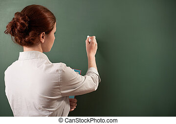 at the blackboard - girl writing on a chalkboard