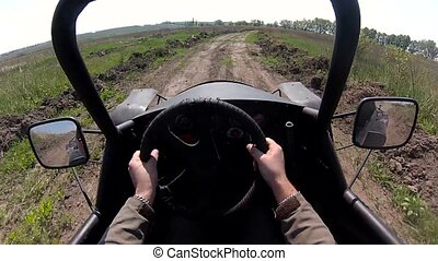 Rider drives the buggy first person view