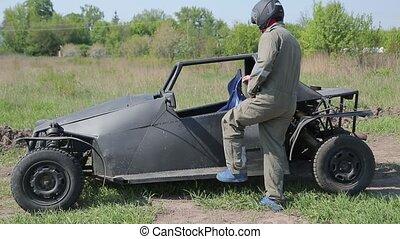 Man in helmet sits in the buggy