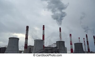 Heat electric power station and cloudy sky, 2 videos in 1 -...