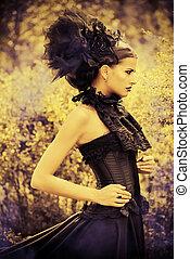 high headwear - Beautiful brunette woman in long black dress...