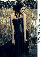 gothic style - Beautiful brunette woman wearing long black...