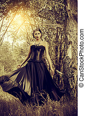 thicket of the forest - Magnificent brunette woman in black...