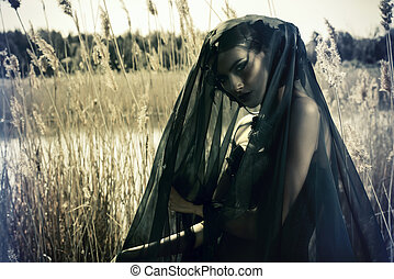 sorrowful lady - Beautiful brunette woman wearing long black...