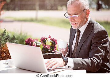 Concentrated businessman sitting at the table - Refresh your...
