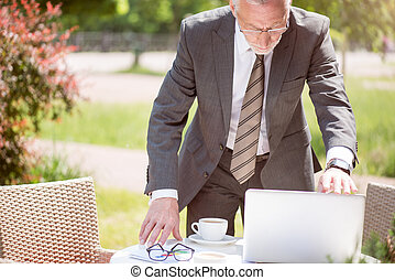 Pleasant man using laptop - Almost done Pleasant serious...