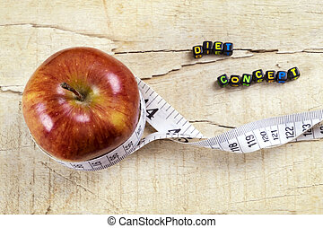 apples and white measuring tape on wooden table - Diet...
