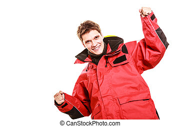 Young male showing gestures Man wearing weatherproof coat...