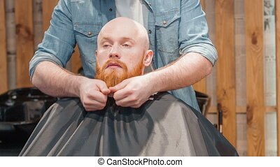 Professional barber styling beard of his client - Follow...