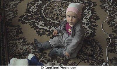 Little girl watching cartoons