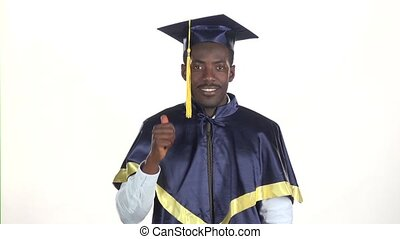 Male graduate shows thumb. White. Slow motion. Close up -...