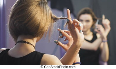 Girl in front of a mirror in a beauty salon.