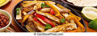Chicken Fajitas with Grilled Onions and Bell Peppers....