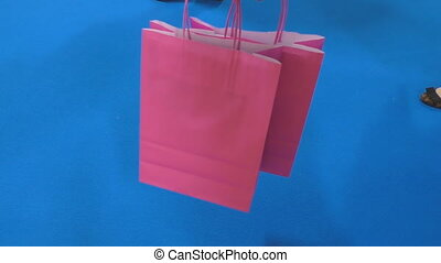 Pink shopping bags and women legs - Feet of two women and...