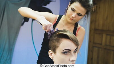 Stylist in a beauty studio does hair dye. She decided to...