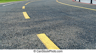 Asphalt road with yellow line