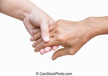 Senior and young holding Across the street hand in hand