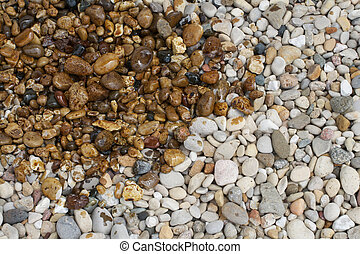 Oil covering rocks - An oil spill pollutes some pristine...