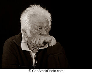 Thoughtful elderly man. - Black and White Portrait of an...