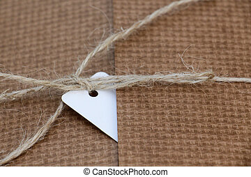 Parcel tied with white string with address label attached
