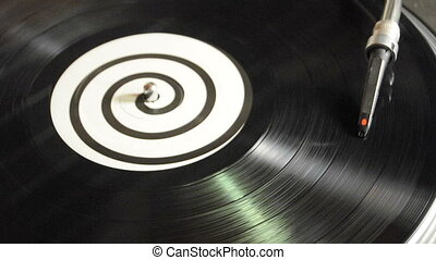 DJ Vinyl Record Spinning Turntable - A DJ LP record spins on...