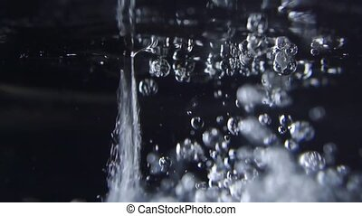 Pouring oil into water Close up slow motion video clip