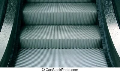 Electric stair in motion - Video footage of an electric...