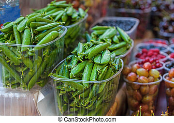 Group of green peas in summer market