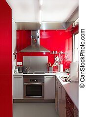 home kitchen in red colors natural window light vertical