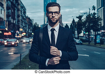 Modern businessman Confident young man in full suit...