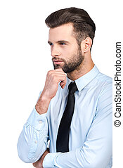 Lost in business thoughts Thoughtful young handsome man in...