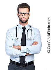 Confident doctor Confident young handsome man in shirt and...