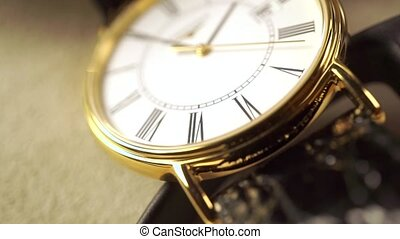 Golden classical wrist watch macro shot. Slow motion video