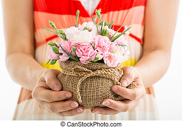 Mothers day ,woman holding blooming carnation flowers in the...