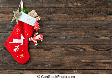 Christmas decoration stocking and toys hanging over rustic...