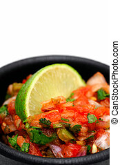 Mexican Salsa - Bowl of spicy homemade tomato salsa topped...