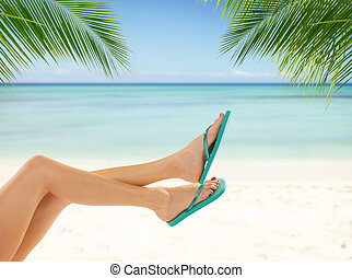 Sexy smooth woman legs with beach on background - Sexy...