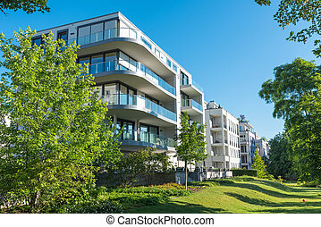 Modern apartment houses with garden seen in Berlin, Germany