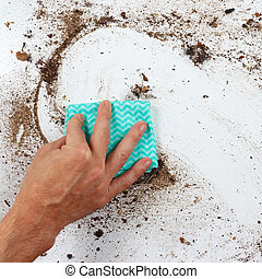 Hand with rag cleans heavily dirty surface - Hand with rag...