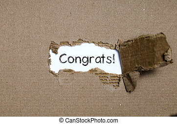 The word congrats appearing behind torn paper